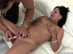 Old perverse slut smiles and closes her eyes with pleasure while a horny dude fists her wet squirting punani before stroking it with sex toys.
