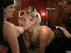 This is a weekly show for a private and closed group. So they gather around and watch how some babes are being abused and fucked hard. So one of the viewers, the sexy blond, joins and takes a big cock!