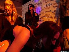 Slutty party lesbians touching their hot bodies with lust and licking their slick muffs in a club