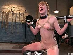 Redhead girl gets tied up and then toyed by a fucking machine. After that she also she gets her pussy toyed and ass fucked at the same time.