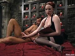 Naughty redhead mistress bounds her sex slave in a basement. Then she steps on his dick and does some other crazy things.