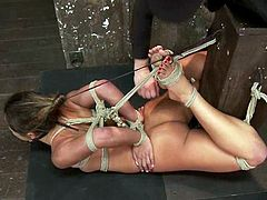 Stunning brunette babe gets tied up and choked with ropes. Later on she gets toyed rough in her tight ass and hairy pussy at the same time.