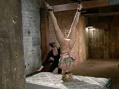 Blonde chick gets tie up and gagged by a mistress. Then the mistress fixes claws to Cherie's pussy lips. Later on this submissive girl also gets toyed with a vibrator.