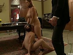 Two naughty and sizzling sirens are being drilled by some vibrators and then their master forces them to fuck each other with a huge strapon!