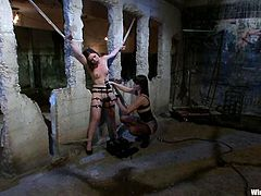 Bobbi Starr is having fun with hot brunette Juliette March in a basement. Bobbi binds and tortures the girl and then slams her snatch with a wired dildo.