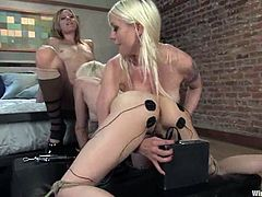 Sexy blonde gets undressed and tied up by two mistresses. After that this babe licks pussies and gets tortured with electricity right in her bedroom.
