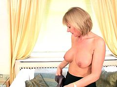 Get a load of this hot solo scene where a horny blonde mature takes off her clothes and gives you a boner as she plays with herself.