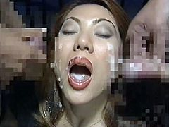 Young japanese babe gets filled with cum in wild bukkake porn orgy