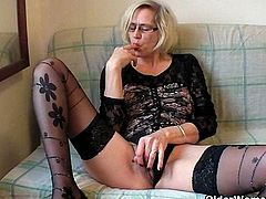Perverted granny named Violett wears sexy black stockings and pushes her fist up her hairy cunt. She moans loud and wants to cum for you so hard, like never before!