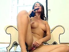 Turned on young looking Ava Dulush with natural perky boobies and round juicy ass in high heels only spreads long legs and polishes trimmed pink pussy all over the room.
