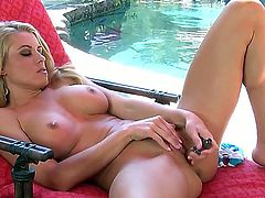 Busty babe Randy Moore with nice legs and ass stays naked near swimming pool before starting to have masturbation. Take a glance at this beauty playing with dildo.