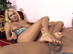 Cute blonde gives unforgettable foot job. Just enjoy her smooth feet and sexy legs in action. She jerks off dick with her feet like professional slut.