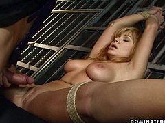 This big breasted chick is getting her pussy fucked with a good, stiff cock while her hands and legs are tied up. Check out this wild BDSM scene and get ready to cum.