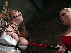Harmony and Princess Donna Dolore are playing dirty games with Charlotte Vale in a basement. They bind and torment the hussy, then beat her ass and fuck her twat with a strapon afterwards.