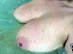 Curvaceous blonde woman with appetizing big natural tits is bathing in bath tub. She squeezes and caresses her big boobs teasing as fuck.