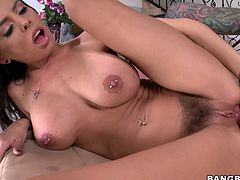 Busty brown-haired hottie Brandy Aniston is playing dirty games with some bald tattooed stud. They have awesome oral sex and then bang in the reverse cowgirl position on a chair.