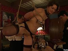 Slutty Cherry Torn lies on a dining table being tied up. She gets her vagina stuffed with big dildo. After that she also get whipped and spanked.