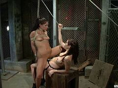 Brown-haired bitch Jade Indica gets bound by Princess Donna Dolore in a basement. Donna tortures Jade and then beats her and fucks her pussy with a strapon.