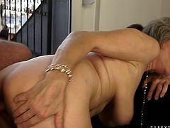 Nasty mature slut sucks fresh cock and sends it deep in her hairy pussy. She moans with pleasure while young dude drills hard her old worn out pussy.