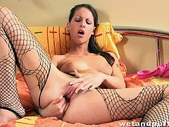 Pantyhose slut drills her tight cunt with a huge toy in superb solo action