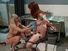 Gorgeous redhead chick in stockings lies in a gynecological chair. She gets tortured with clothespins and electricity by her blonde mistress.
