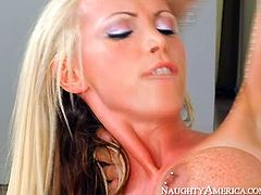 Stunning blonde porn model with big fake boobs is riding solid prick of Johnny Castle. Then she bends over the couch getting rammed hard doggy style. Arousing sex video presented by Naughty America.