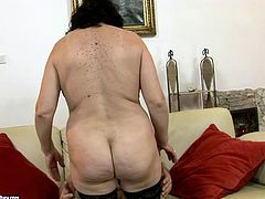 Shabby looking old brunette BBW in seductive black stockings tops a horny dad for a ride in reverse cowgirl style before she turns around to continue her ride.