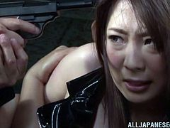 The Yakuza have a girl in a red latex costume, trapped in one of their hideouts to use her as a sex slave. Another sexy girl delivers a package and discovers them. The Yakuza catch her and make her watch as they gang bang their slave.