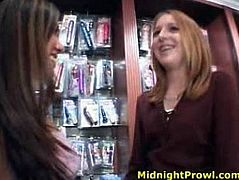 Kinky tall and slim straight haired lesbos meet each other in the sex shop. Horny chicks with natural tits desire to have steamy sex right away and kiss passionately.