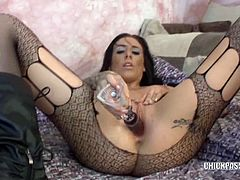 Austin Lynn is a hot tattooed babe with big tits. She's rocking that dildo with her dripping wet pussy.