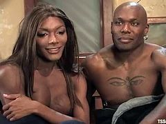 Jack Hammer is having a good time with ebony tranny Mistress Amyiaa. They suck each other's black pricks and then the ladyboy pounds Jack's ass deep and hard.