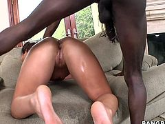Check out this hardcore scene where a slutty babe takes a serious pounding from a monster black cock after her ass gets oiled up.