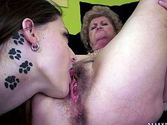 Ruined fat granny lies with legs spread aside welcoming steamy tongue fuck of her bushy cunt from a playful brunette amateur in pov sex scene before they switch the roles in steamy lesbian sex video by 21 Sextury.