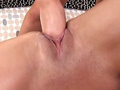 Flexible brunette spreads her legs wide and two studs trust fists in her stretched pussy cave. She is a proprietress of hell working pussy which can be satisfied only with fisting.