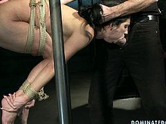 Kinky black haired cutie with sweet tits is mad about bondage. So spoiled dude ties her up with ropes and fixes above the floor to fuck her wet cunt from behind too rough for orgasm.