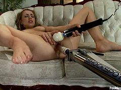 Pretty blonde chick lies on a sofa and toys herself with a vibrator. Then she also gets her tight vagina drilled by the fucking machine.