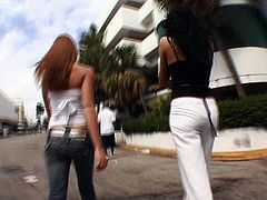 Lusty girls are walking on a street wearing outright clothes. Later they flash their boobs kissing passionately in french way.