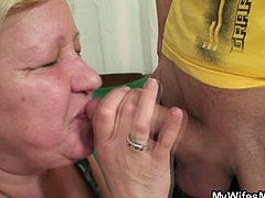 When his wifey was outside, her mom decided to has some fun with her young hubby. She sucked him off nice and he fucked her fat cunt!