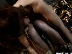 Ruined brunette doxy is not new to BDSM sex plays. She gets her body tied before an aroused lesbian starts fisting her bottomless vagina and later pokes it with a dildo in BDSM-involved sex video by 21 Sextury.