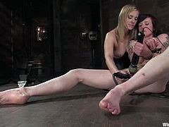 Maitresse Madeline features this lesbian BDSM femdom video with torture, bondage and toying where she dominates a girl.