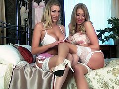 Blonde moms Danielle and Lexi are trying out some very sexy lingerie. They look so fine that even they are turned on by their outfits. The blondes decide it's time to try something else out, their bodies. Look at them how they lustfully kiss and play with those big, naughty boobs. Things are getting hot!