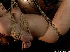 Ample red-haired mature gets her body tied with rope before a sophisticated domina forces her give a head to a dildo before uses it to poke her soaking vagina in BDSM-styled sex video by 21 Sextury.