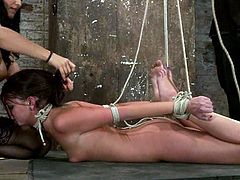 Isis Love and her man are enjoying to torture this sexy babe Cassandra Nix. They tie her up hard and she sicks that dick, while Isis fingers her wet pussy!