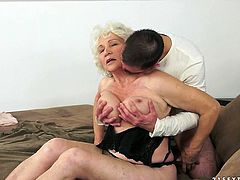 Perverse dude is a real fan of gerontrophil. He hooks up with a curvy grey-haired granny to enjoy sucking her big slack tits before he goes down to her bearded pussy to eat it.