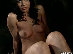 Cheesecake brunette candy Clarisse gets suspended by creative brunette domina so she can drill her tight pussy with fingers. Later she takes a massive ruffled dildo to continue poking her snatch in BDSM-involved sex video by 21 Sextury.