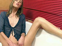 Awesome pee fetish woman massages her clitoris