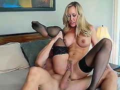 Stunning blonde milf Brandy Love with round hooters and smoking hot fit body in stockings only screams while muscled Johnny Sins with shaved head drilled deep her trimmed pussy.
