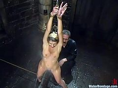 This juicy and horny siren Megan Joy is going through some pain. She gets tied up and then her master takes a control of her breath, dipping her in the water!