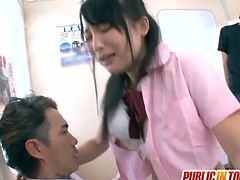 Kinky Japanese girl in school uniform lifts her skirt up and gets fingered. After that she sucks two dicks and gets her teen pussy drilled.