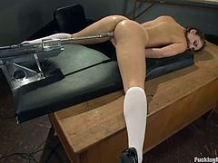 Sweet babe takes her school uniform off and lies down on a table. She spreads her sexy legs and gets her soaking pussy drilled by the fucking machine.